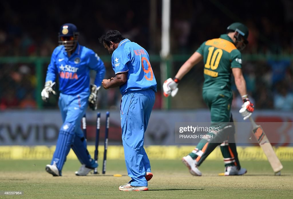 India's Amit Mishra (C) celebrates after South Africa's <a gi-track='captionPersonalityLinkClicked' href=/galleries/search?phrase=David+Miller+-+Cricket+Player&family=editorial&specificpeople=15061693 ng-click='$event.stopPropagation()'>David Miller</a> (R) was stumped off his bowling by India's captain Mahendra Singh Dhoni (L) during the first one day international (ODI) cricket match between India and South Africa at Green Park Stadium in Kanpur on October 11, 2015.