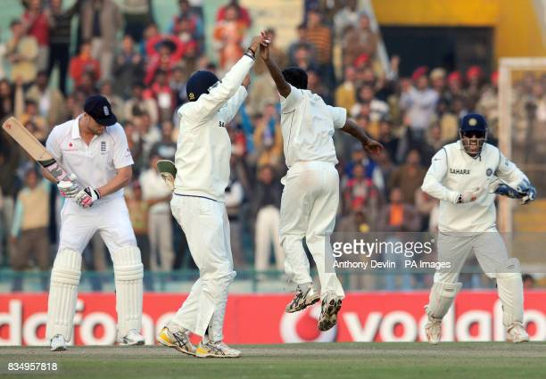 India's Amit Mishra celebrates with Gautam Gambhir after Gambhir caught England's Andrew Flintoff off Mishra's bowling for 62 during the third day of...