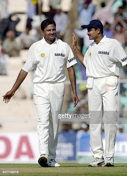 India's Anil Kumble congratules Javagal Srinath after he took the wicket of Richard Dawson at the score of 11 on the second day of second Test match...