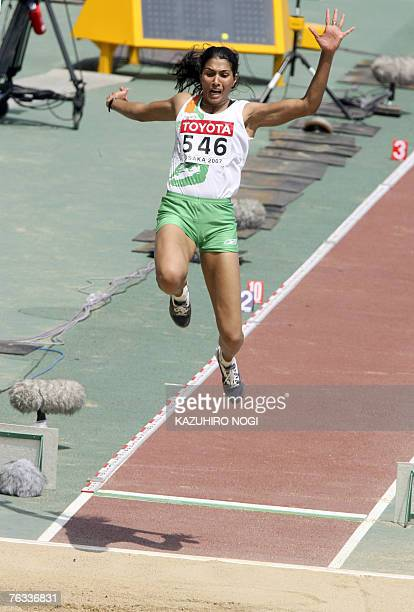 India's Anju Bobby George competes during the women's long jump qualifications 27 August 2007 at the 11th IAAF World Athletics Championships in Osaka...