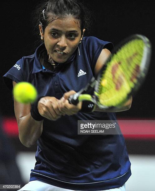 India's Ankita Raina returns to the Philippines' Katharina Lehnert in the Fed CupOceana Group II Tennis Championship final at Fateh Maidan Tennis...
