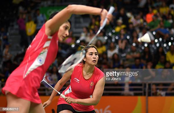 India's Ashwini Ponnappa and India's Jwala Gutta and returns to Thailand's Sapsiree Taerattanachai and Thailand's Puttita Supajirakul during their...