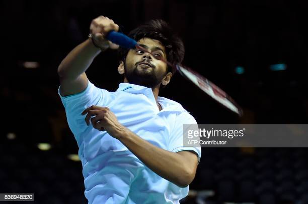 India's B Sai Praneeth returns against Hong Kong's Wei Nan during their round one men's singles match during the 2017 BWF World Championships of...