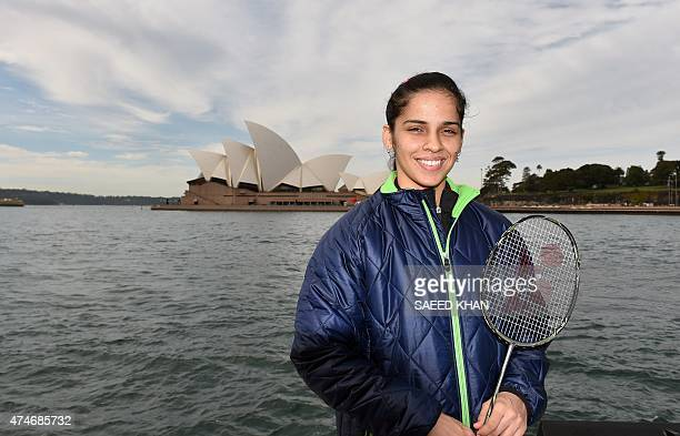 India's badminton player Saina Nehwal currently world's number 1 poses for pictures in front of an iconic Opera House in Sydney on May 25 2015 World...