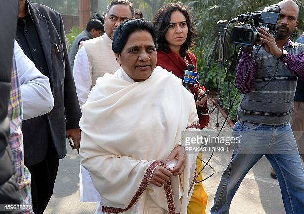 India's Bahujan Samaj Party Leader Mayawati arrives in Parliament in New Delhi on November 27 2014 The government is likely to continue discussion on...