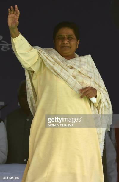 India's Bahujan Samaj Party leader Mayawati waves to the crowd upon her arrival at an election rally in Ghaziabad on February 7 2017 Elections in...