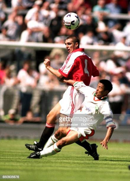 India's Baichung Bhutia dives in for a tackle on Fulham's Andy Melville