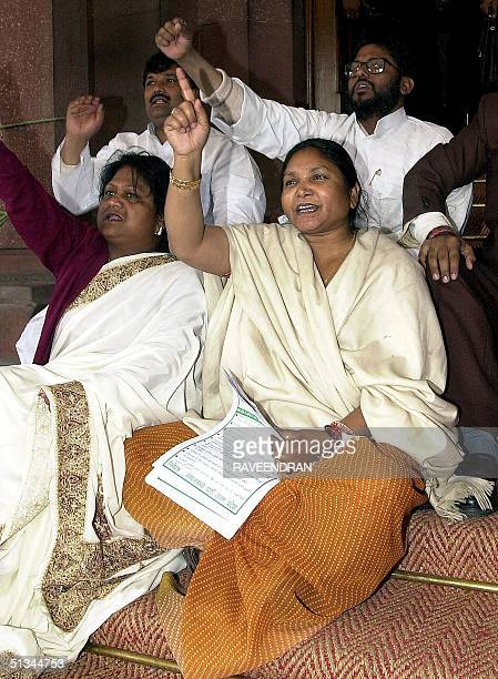 India's 'Bandit Queen' turned parliamentarian Phoolan Devi shouts antiBJP slogans as she sits with other MPs in the main entrance of the federal...