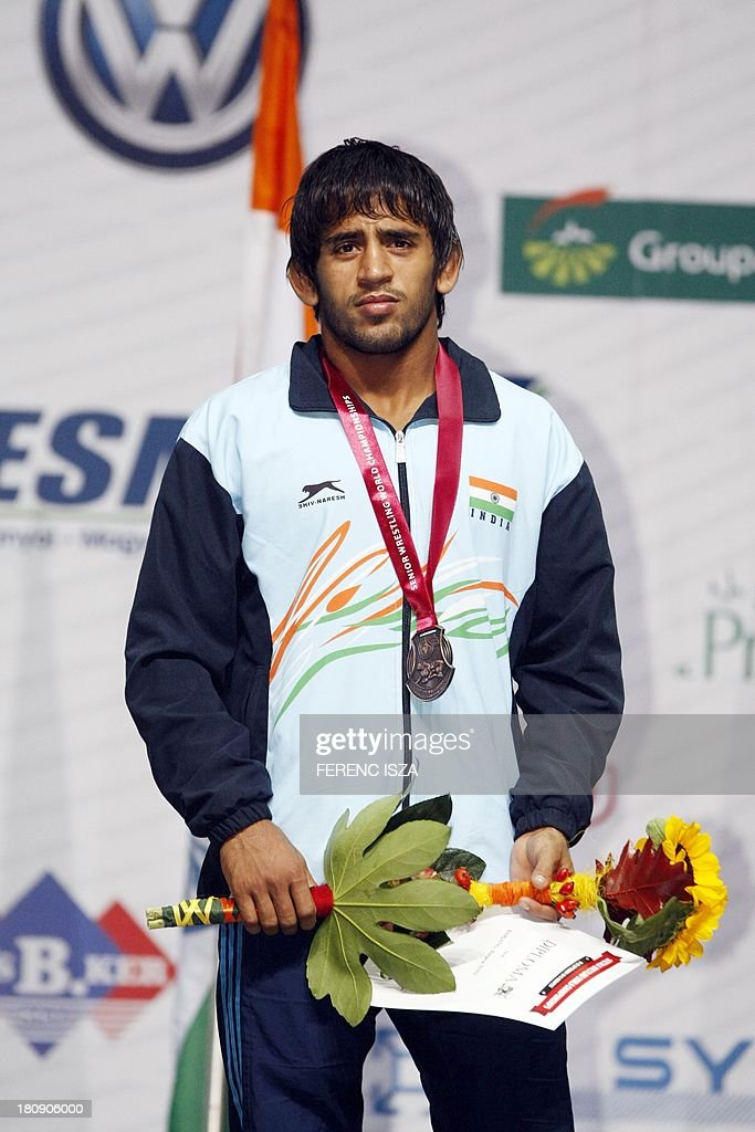 India's Barjang Barjang celerates his bronze medal on the podium of the men's free style 60 kg category of the World Wrestling Championships in...