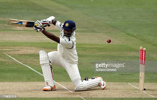 India's batsman Abhinav Mukund turns to see the bails go flying after being clean bowled for 49 runs by England's Stuart Broad during day three of...