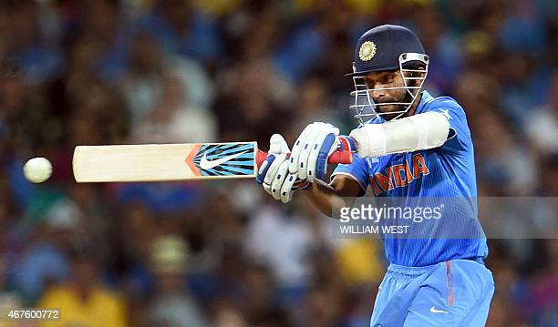 India's batsman Ajinkya Rahane pulls a ball away from the Australian bowling during their 2015 Cricket World Cup semifinal match in Sydney on March...
