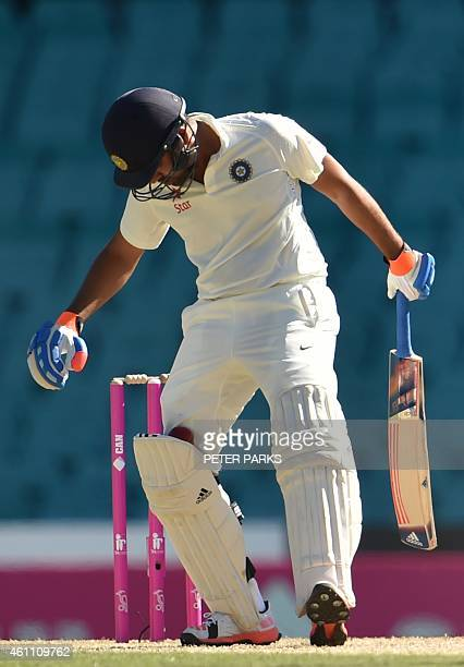 India's batsman Karn Sharma catches the ball in his pads during day two of the fourth cricket Test between Australia and India at the Sydney Cricket...