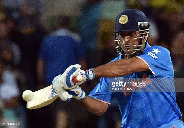 India's batsman Mahendra Singh Dhoni plays a shot against Australia during the Cricket World Cup semifinal at Sydney Cricket Ground on March 26 2015...