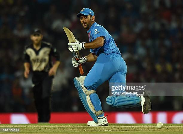India's batsman Mahendra Singh Dhoni plays a shot during the World T20 cricket tournament match between India and New Zealand at The Vidarbha Cricket...