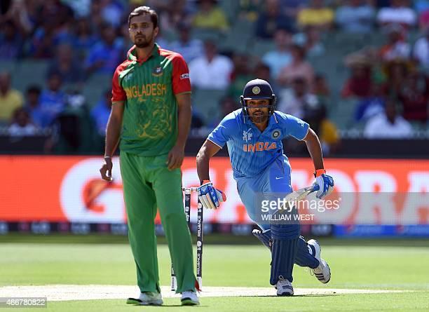 India's batsman Rohit Sharma takes more runs from Bangladesh bowler Mashrafe Mortaza during their 2015 Cricket World Cup quarterfinal match in...