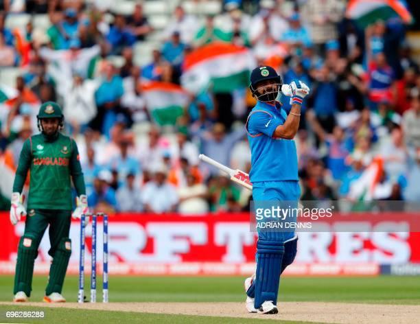 India's batsman Virat Kohli celebrates hitting the winning runs in the ICC Champions Trophy semifinal cricket match between India and Bangladesh at...
