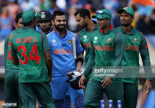 India's batsman Virat Kohli is congratulated by Bangladesh players after winning the ICC Champions Trophy semifinal cricket match between India and...