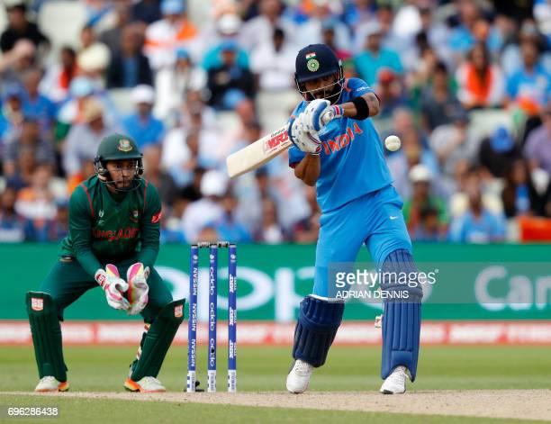 India's batsman Virat Kohli plays a shot during the ICC Champions Trophy semifinal cricket match between India and Bangladesh at Edgbaston in...