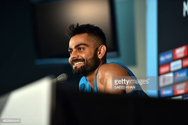 India's batsman Virat Kohli smiles during a press conference at the Melbourne Cricket Ground on February 21 ahead of their 2015 Cricket World Cup...