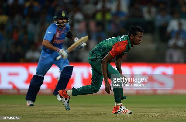 India's batsman Virat Kohli takes a run while Bangladesh bowler Al Amin Hossain misses a catch during the World T20 cricket tournament match between...