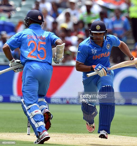India's batsmen Rohit Sharma and Shikhar Dhawan take a first run against Pakistan during the Pool B 2015 Cricket World Cup match between India and...