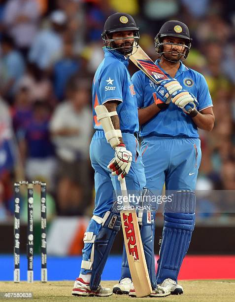 India's batsmen Rohit Sharma and Shikhar Dhawan wait for the third umpire's decision during the Cricket World Cup semifinal at Sydney Cricket Ground...