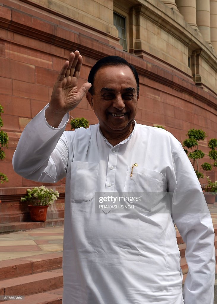 India's Bharatiya Janata Party (BJP) senior Leader and member of parliament Subramanium Swamy waves as he arrives at Parliament House in New Delhi on May 3, 2016. / AFP / PRAKASH