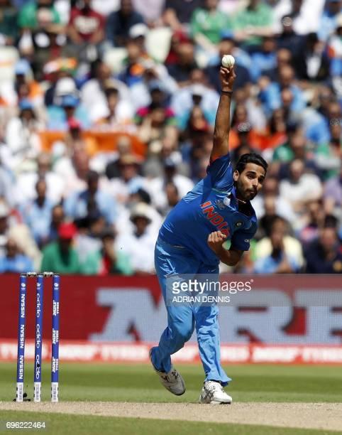 TOPSHOT India's Bhuvneshwar Kumar bowls during the ICC Champions Trophy semifinal cricket match between India and Bangladesh at Edgbaston in...