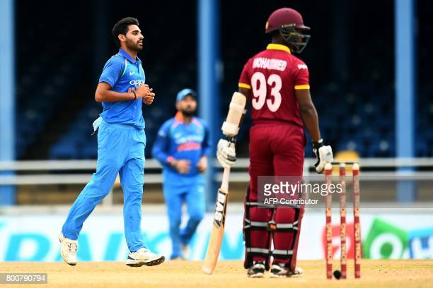 India's Bhuvneshwar Kumar celebrates after dismissing West Indies' Jason Mohammed during the second One Day International match between West Indies...