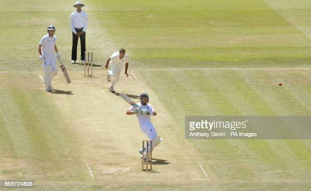 India's Bhuvneshwar Kumar celebrates as Ravindra Jadeja takes the catch of England's Ian Bell during day two of the second test at Lord's Cricket...