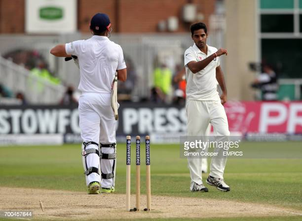 India's Bhuvneshwar Kumar celebrates taking the wicket of England's Liam Plunkett