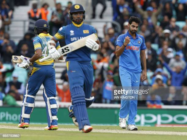 Indias Bhuvneshwar Kumar celebrates taking the wicket of Sri Lankas Niroshan Dickwella for 7 runs during the ICC Champions Trophy match between India...