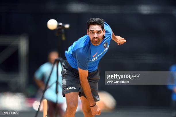 India's Bhuvneshwar Kumar delivers a ball during a practice session at the Queen's Park Oval in Port of Spain Trinidad on June 22 ahead of the first...