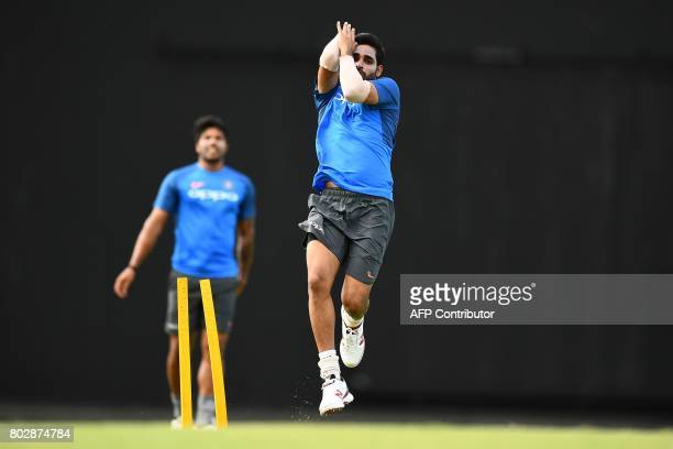India's Bhuvneshwar Kumar delivers a ball during a practice session at the Sir Vivian Richards Cricket Ground in St John's Antigua on June 28 ahead...