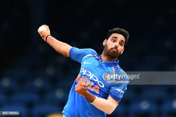 India's Bhuvneshwar Kumar delivers a ball during the second One Day International match between West Indies and India at the Queen's Park Oval in...