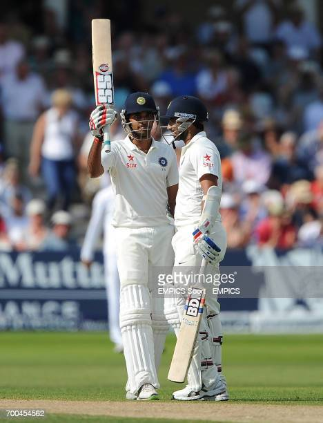 India's Bhuvneshwar Kumar raises his bat after reaching a half century in partnership with Mohammed Shami against England during day two of the first...