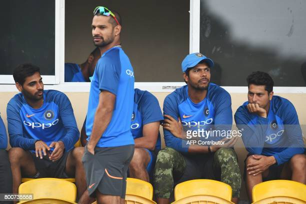 India's Bhuvneshwar Kumar Shikhar Dhawan Umesh Yadav and Kuldeep Yadav wait for the start of the second One Day International match between West...