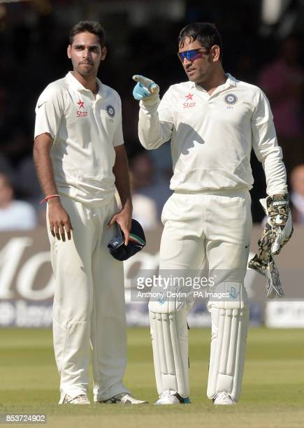 India's Bhuvneshwar Kumar speaks with MS Dhoni during day two of the second test at Lord's Cricket Ground London