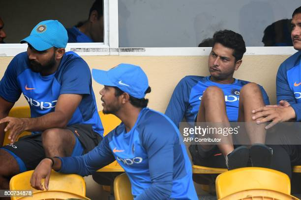 India's Bhuvneshwar Kumar Umesh Yadav and Kuldeep Yadav wait for the start of the second One Day International match between West Indies and India at...