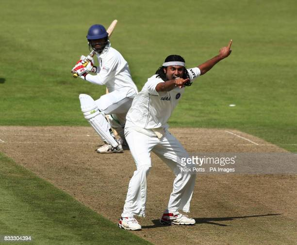India's bowler Ranadeb Bose wins an LBW appeal and traps Sri Lanka A batsman Kaushal Lokuarachchi during the Tour match at Grace Road Leicester