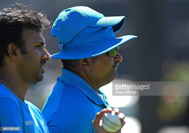 India's bowling coach Bharat Arun looks on during a final training session ahead of their Pool B 2015 Cricket World Cup match against the United Arab...