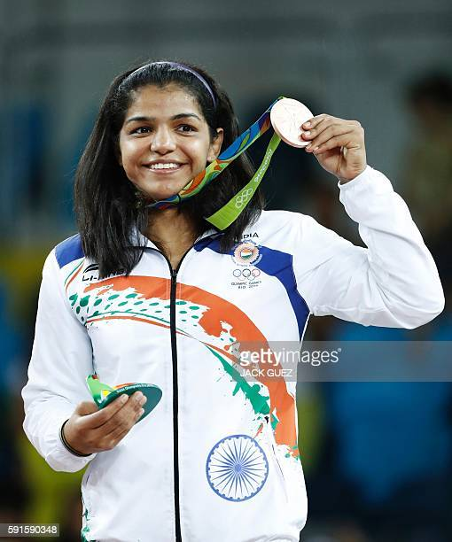TOPSHOT India's bronze medallist Sakshi Malik stands on the podium at the end of the women's 58kg freestyle wrestling event at the Carioca Arena 2 in...