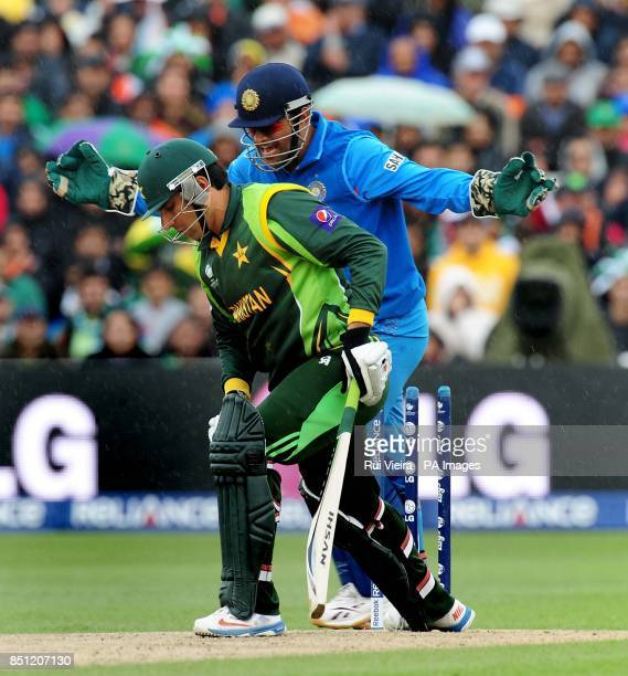 India's captain Mahendra Dhoni celebrates after Pakistan's MisbahulHaq bowled by India's Ravindra Jadeja for 22 during the ICC Champions Trophy match...