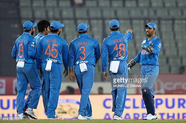 India's captain Mahendra Singh Dhoni celebrates with teammates after the dismissal of Sri Lanka's Shehan Jayasuriya during the Asia Cup T20 cricket...
