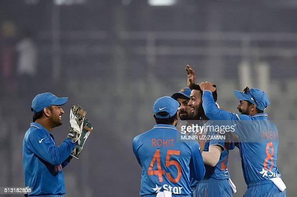India's captain Mahendra Singh Dhoni congratulates India's Hardik Pandya after the dismissal of Sri Lanka's Tillakaratne Dilshan during the Asia Cup...