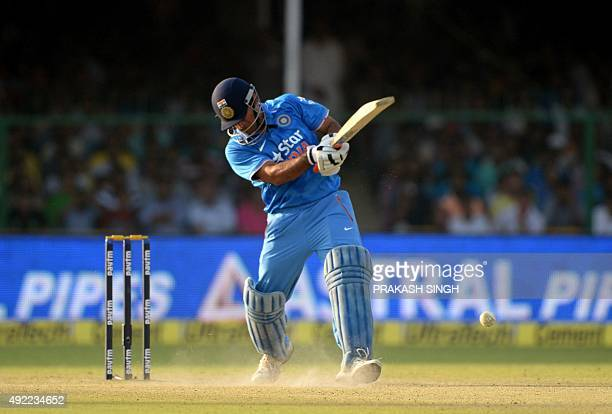 India's captain Mahendra Singh Dhoni plays a shot during the first one day international cricket match between India and South Africa at Green Park...