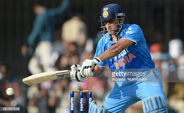 India's captain Mahendra Singh Dhoni plays a shot during the second one day international cricket match between India and South Africa at The Holkar...