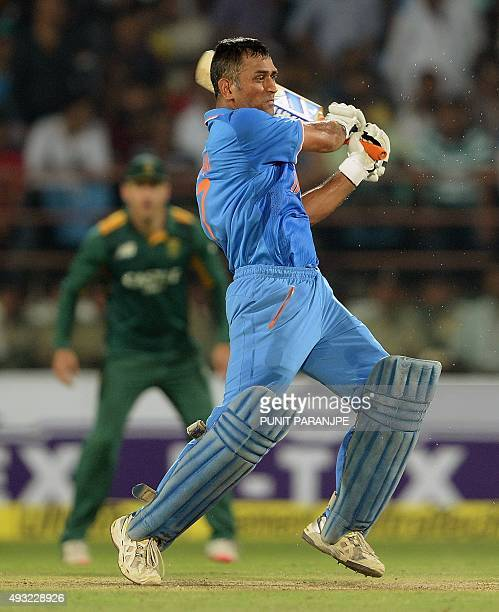 India's captain Mahendra Singh Dhoni plays a shot during the third one day international cricket match between India and South Africa at The...