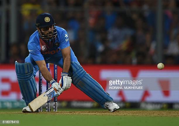India's captain Mahendra Singh Dhoni plays a shot during the World T20 semifinal match between India and West Indies at The Wankhede Cricket Stadium...