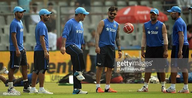 India's captain Mahendra Singh Dhoni Virat Kohli Suresh Raina Rohit Sharma Ajinkya Rahane and Bhuvneshwar Kumar attend a training session on the eve...